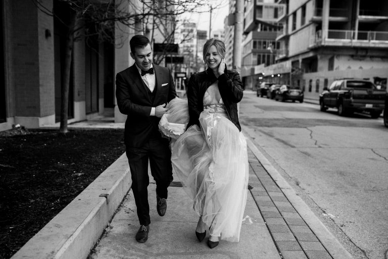 bride and groom walking in Toronto