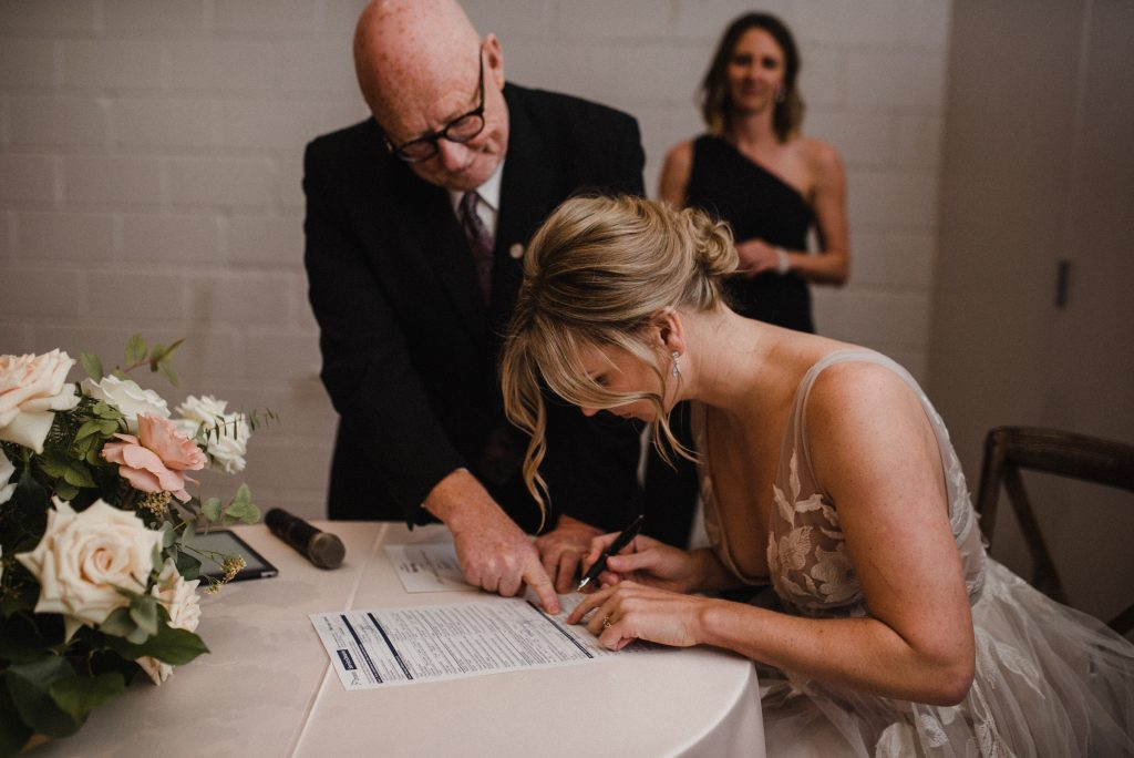 bride signing papers