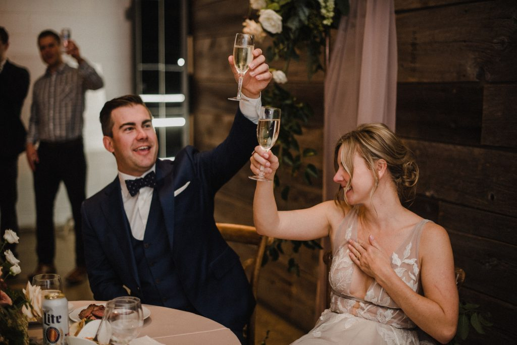 bride and groom making a toast