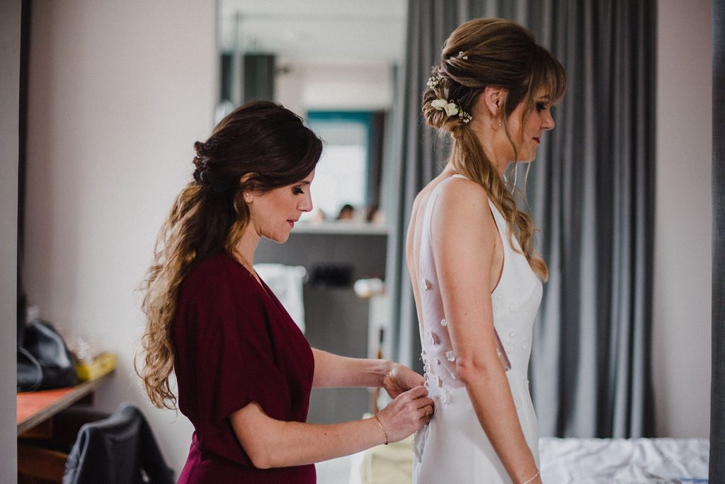 Bridesmaid getting bride ready