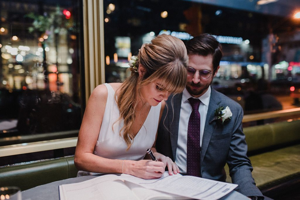 Bride signing legal papers