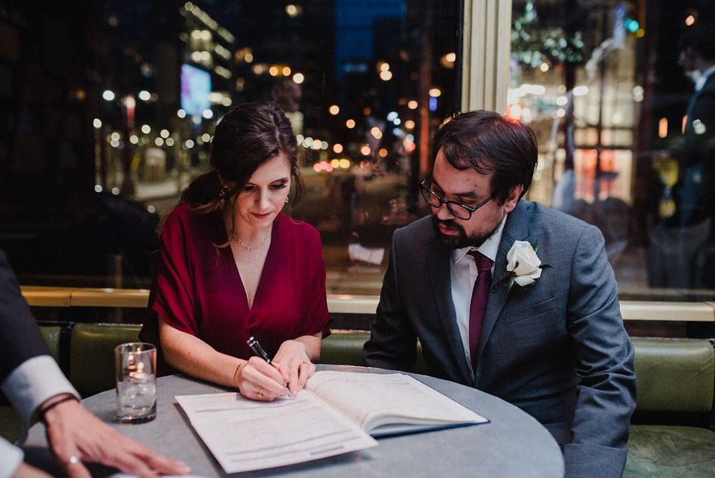 Witnesses signing wedding papers