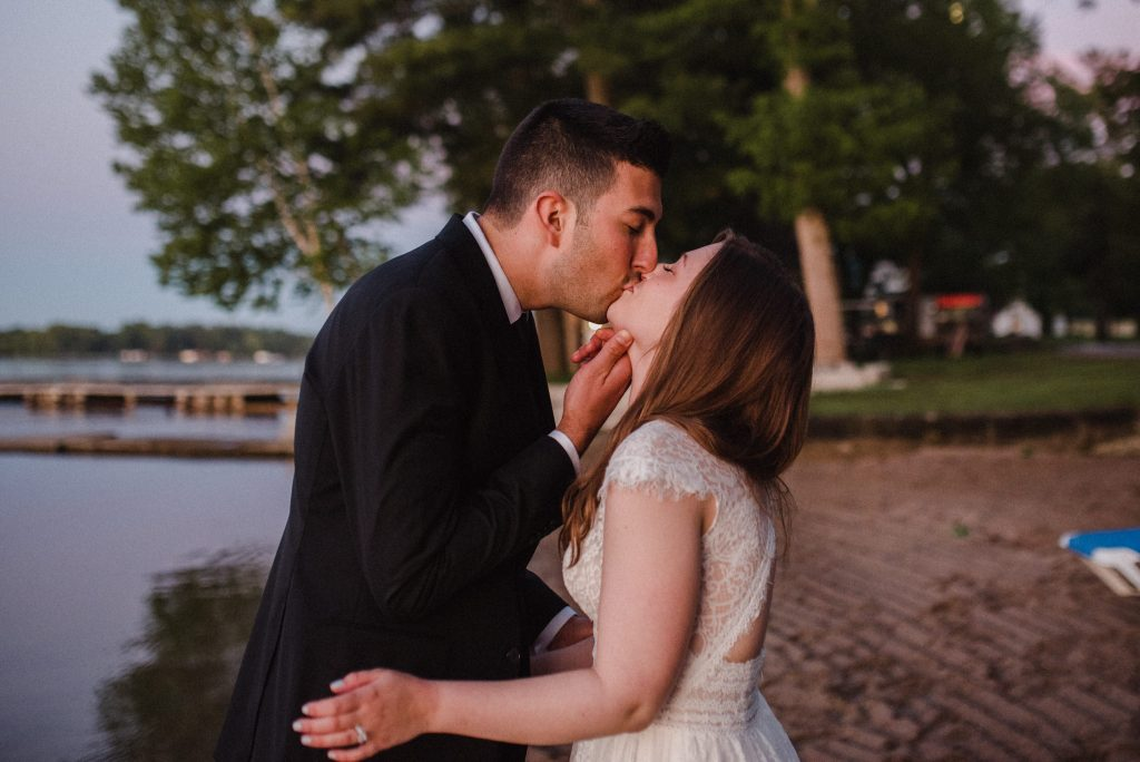 Bayview Wildwood Resort Wedding - groom kisses bride on the beach