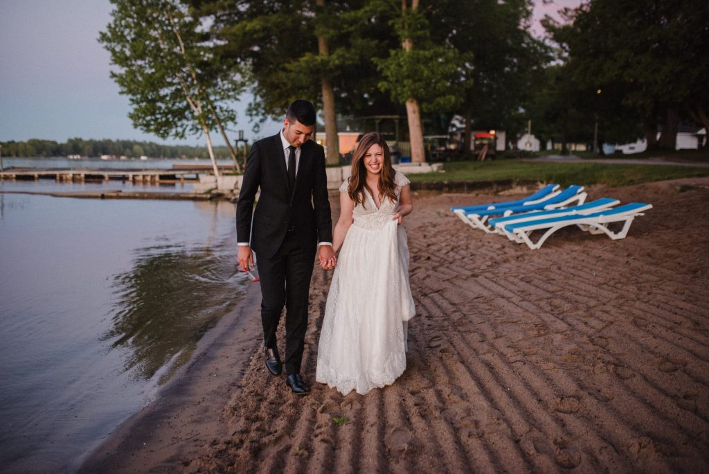 Bayview Wildwood Resort Wedding - bride and groom walk on the beach