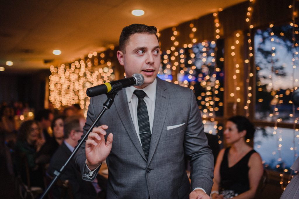 Bayview Wildwood Resort Wedding - speech with string lights behind