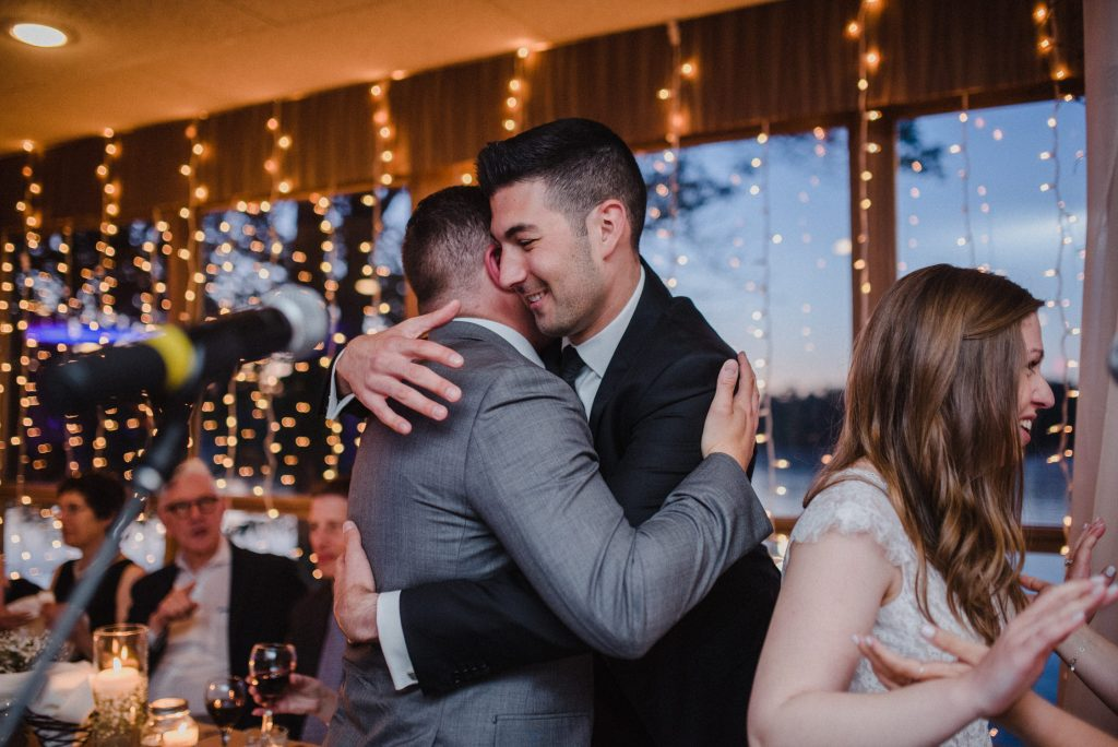 Bayview Wildwood Resort Wedding - groom hugs friend