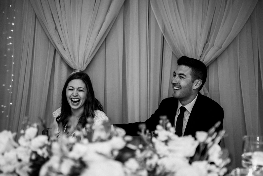 Bayview Wildwood Resort Wedding - bride and groom laughing at dinner