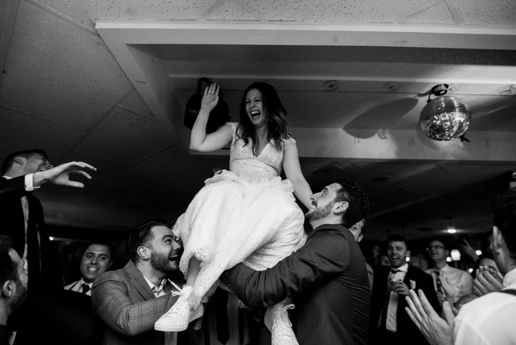 Bayview Wildwood Resort Wedding - bride lifted on chair during horah dance