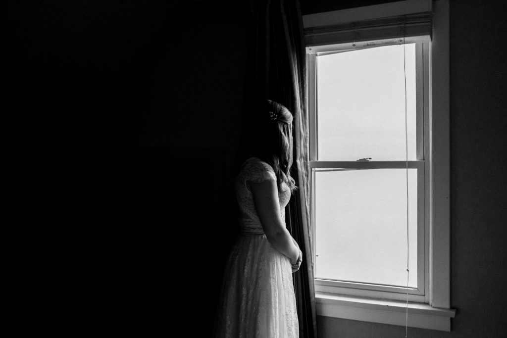 Bayview Wildwood Resort Wedding - bride looking out window