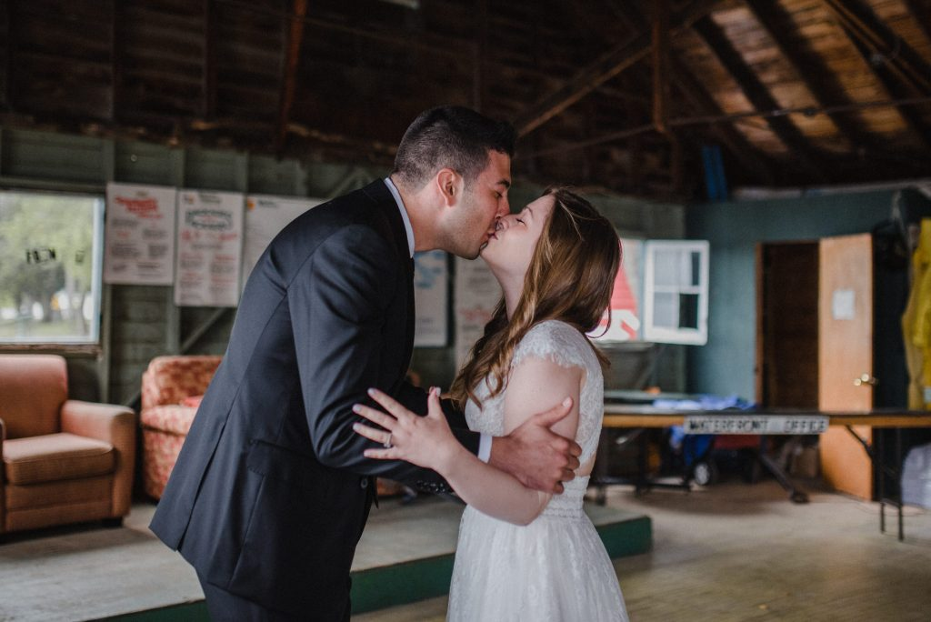 Bayview Wildwood Resort Wedding - first look kiss in boathouse
