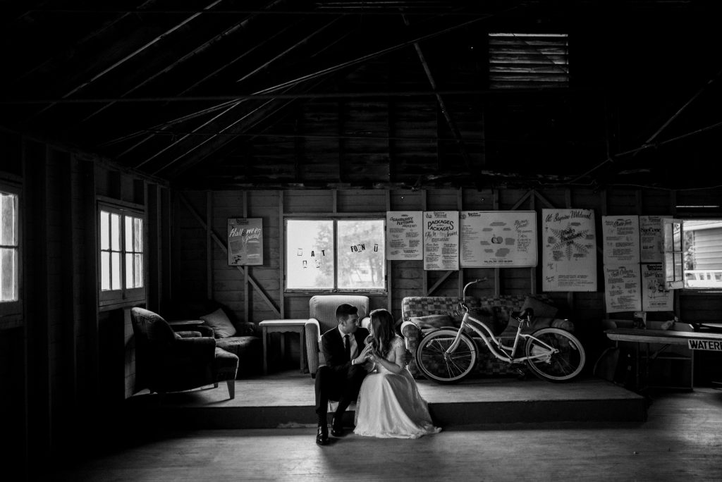 Bayview Wildwood Resort Wedding - bride and groom snuggle in boathouse