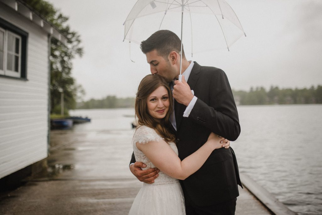 Bayview Wildwood Resort Wedding - bride and groom in the rain under clear umbrella