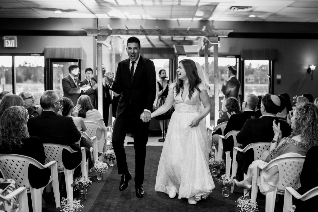 Bayview Wildwood Resort Wedding - groom fist pumps down the aisle