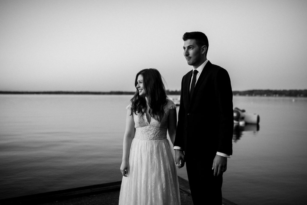 Bayview Wildwood Resort Wedding - bride and groom on the dock at sunset