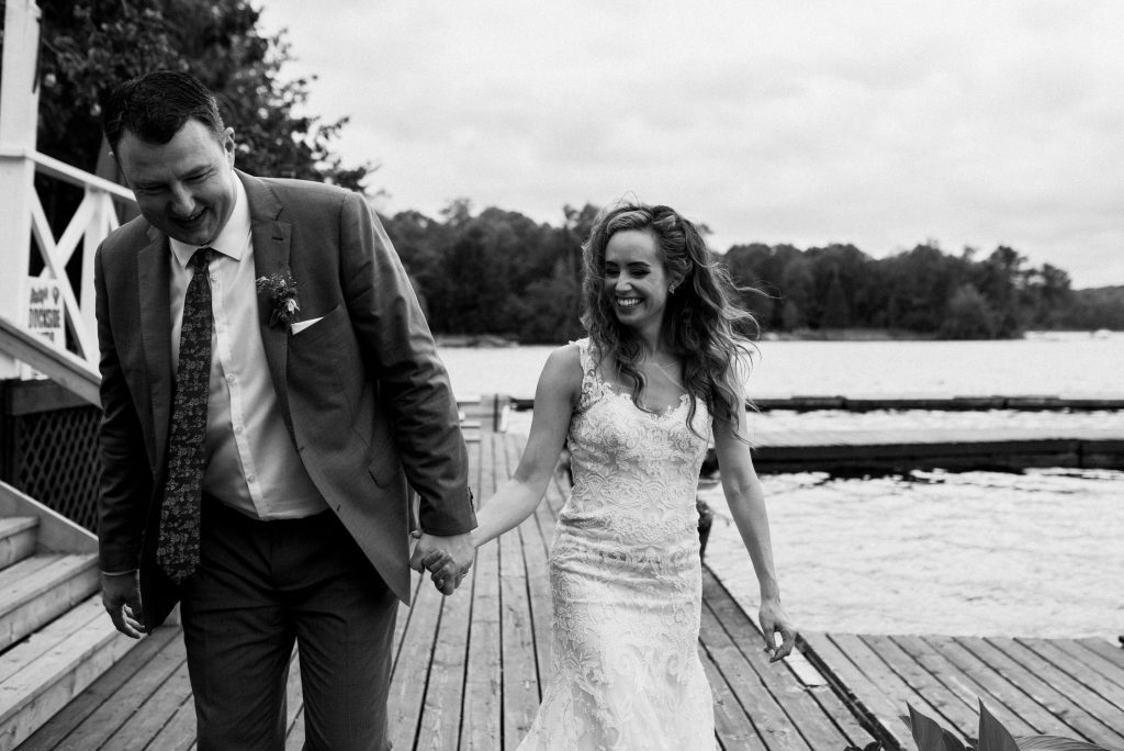 Bonnieview Inn Wedding - bride and groom laugh on the dock