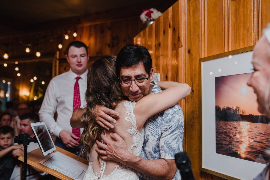 Bonnieview Inn Wedding - bride hugs father