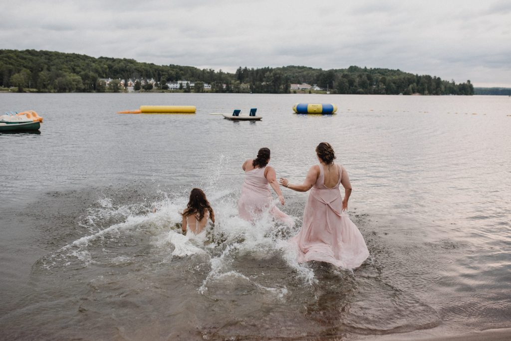 Bonnieview Inn Wedding - bride jumps in lake with bridesmaids