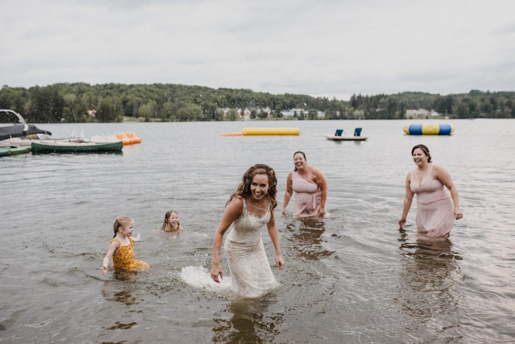 Bonnieview Inn Wedding - bride stand in lake laughing with wet dress