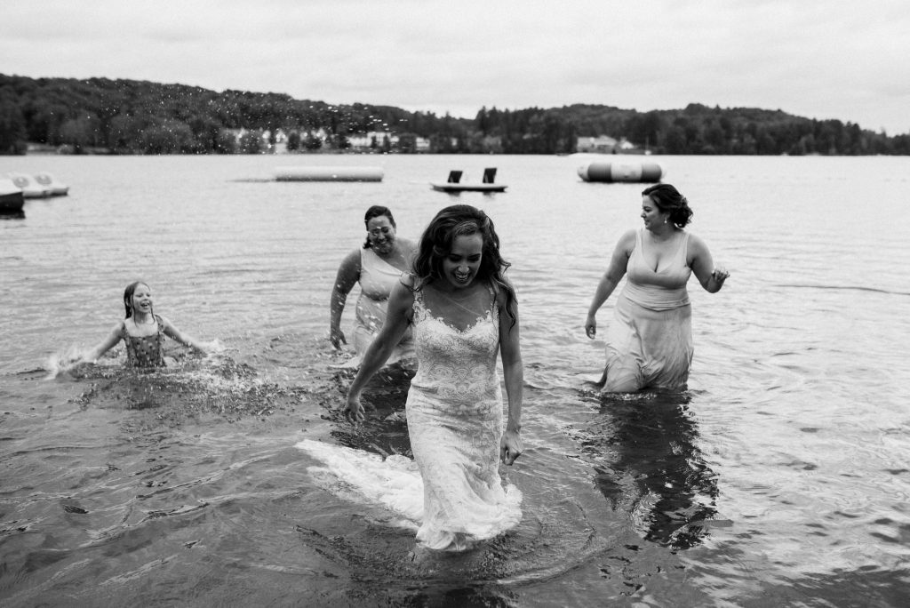 Bonnieview Inn Wedding - bride wades through lake in wedding dress