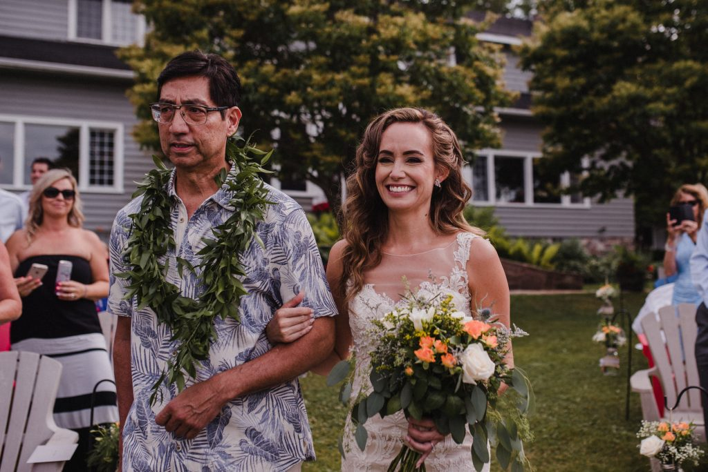 Bonnieview Inn Wedding - bride walking down the aisle with father in lei