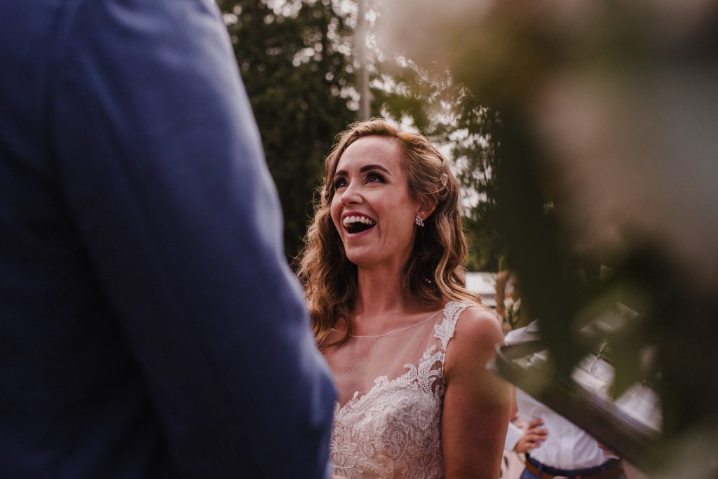 Bonnieview Inn Wedding - bride smiles with joy during ceremony