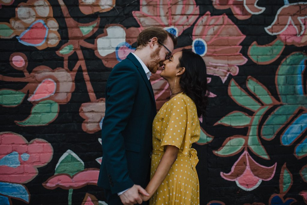 Liberty Village Engagement - couple kissing in front of mural
