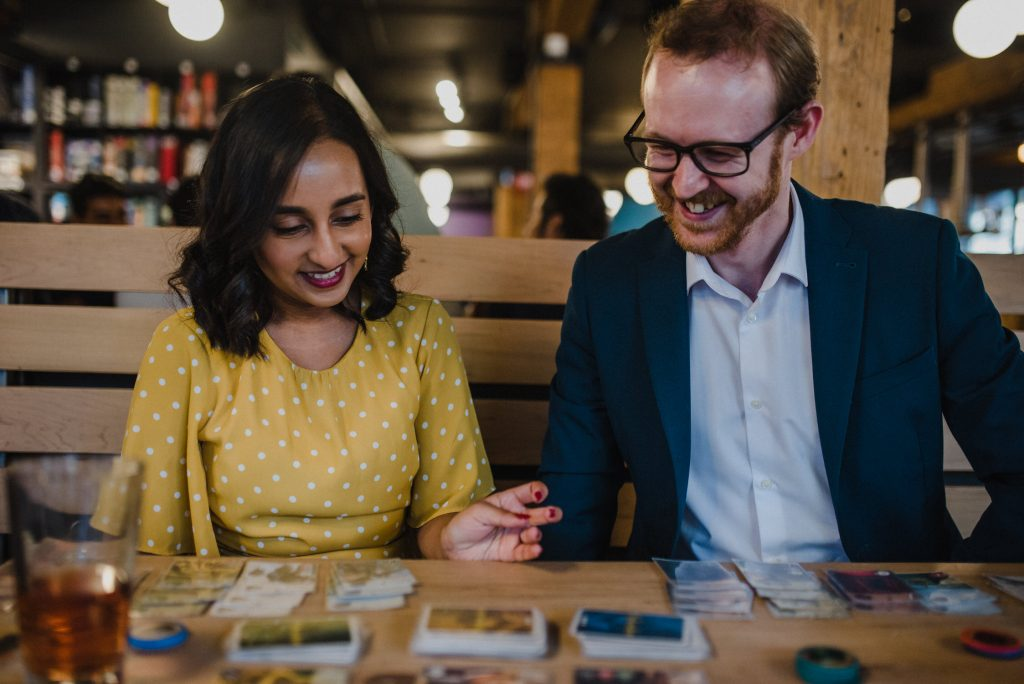 Snakes & Lattes Engagement - Couple playing card game