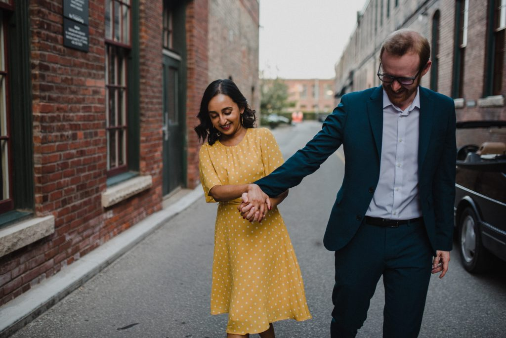 Liberty Village Engagement - couple play in alleyway