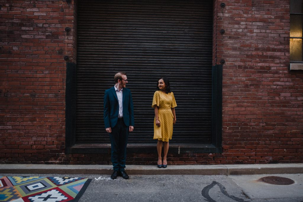 Liberty Village Engagement - couple pose in front of loading dock