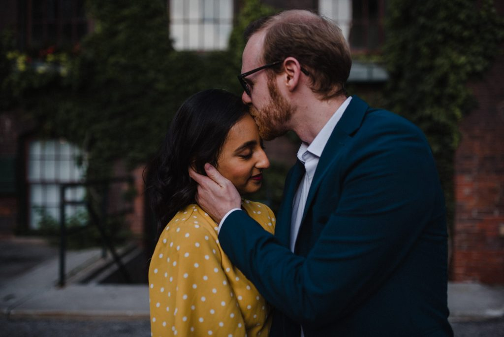 Liberty Village Engagement - man kisses fiances forehead
