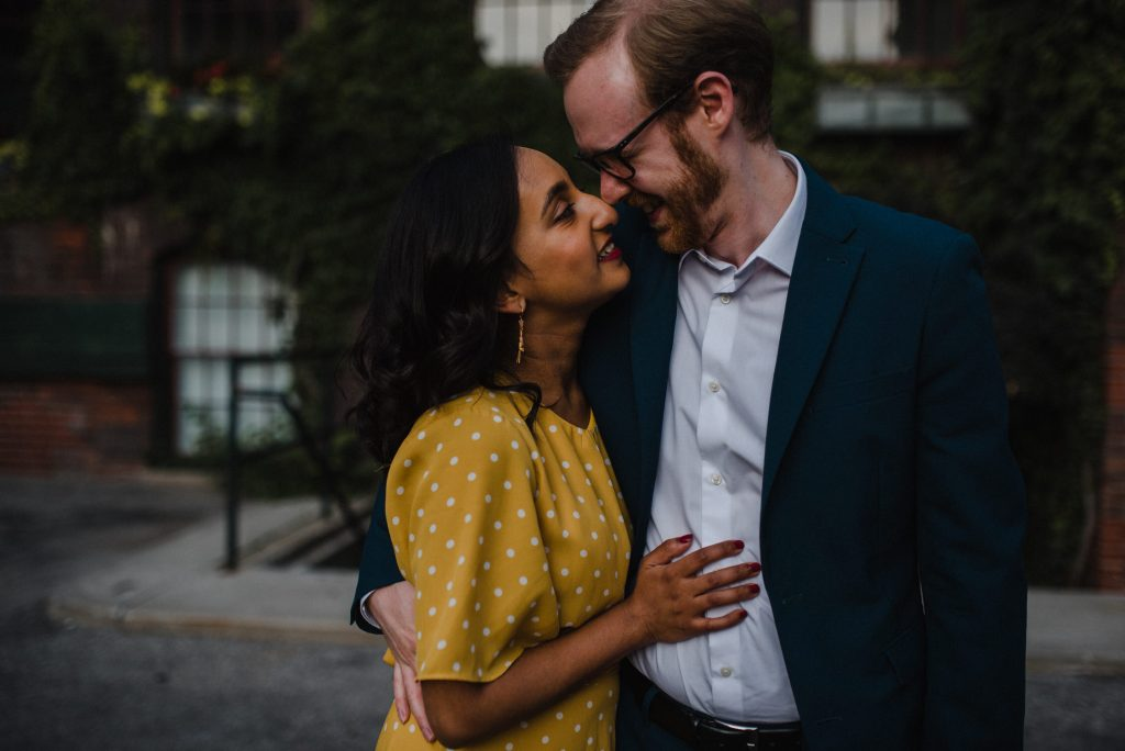 Liberty Village Engagement - couple embrace in urban alleyway