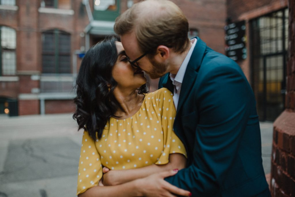 Liberty Village Engagement - couple kiss in urban alleyway
