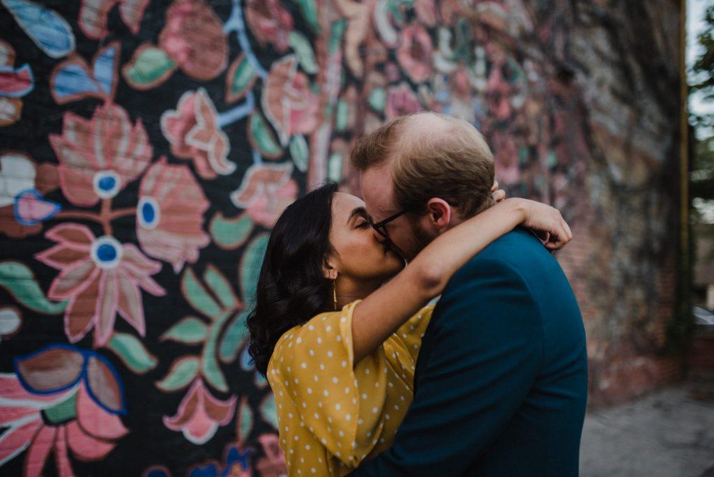 Liberty Village Engagement - couple kiss near mural