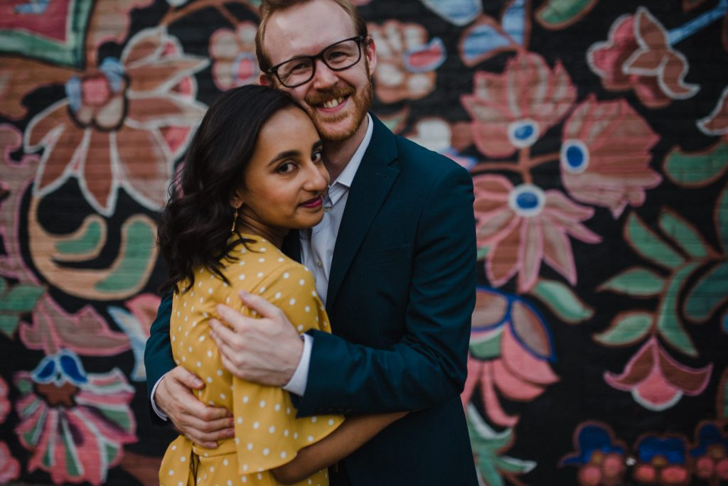 Liberty Village Engagement - couple smile in front of wall mural