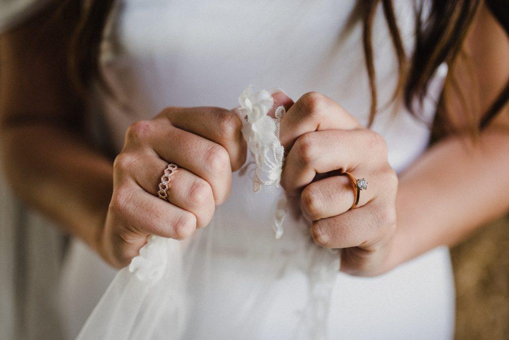 dyment's farm wedding - bride's hands holding veil