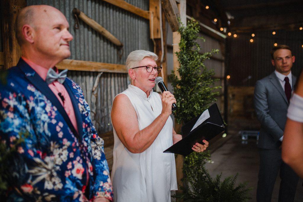 dyment's farm wedding - wedding officiant in barn
