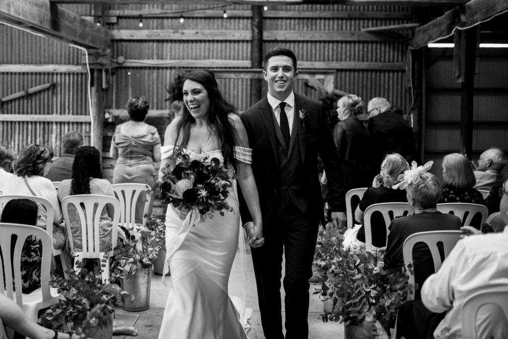 dyment's farm wedding - bride and groom walking down aisle