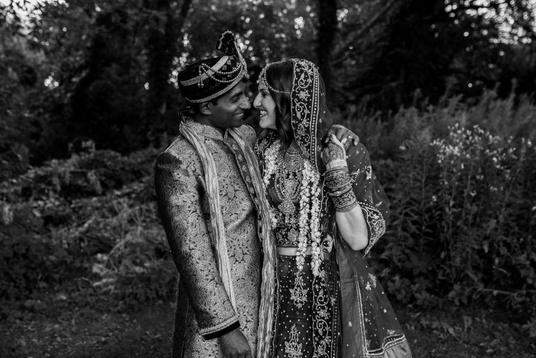 La Maquette Wedding - Couple pose in the forest at Vishnu Mandir Temple - Tami Klein