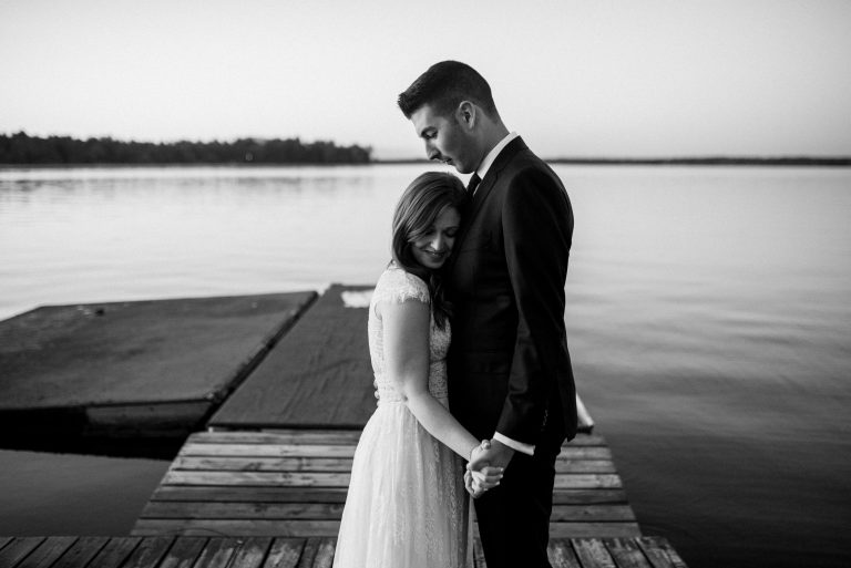 Bayview Wildwood Resort Wedding - Couple Embrace on the dock