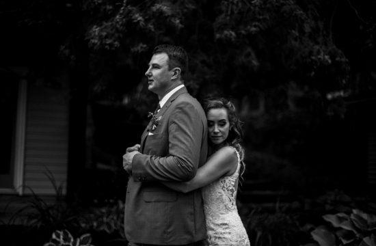 Bonnie View Inn Wedding - Couple embrace near the woods
