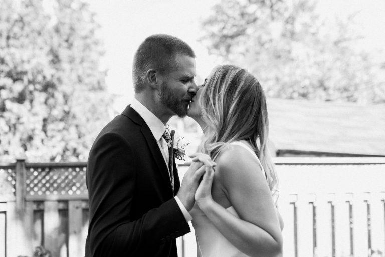 Toronto Backyard Wedding - Bride and groom kiss in the backyard